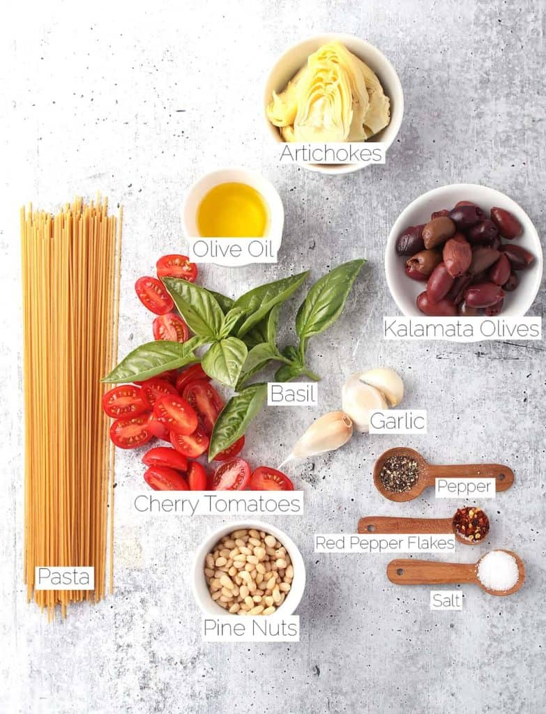 Ingredients for Mediterranean Pasta on a concrete countertop