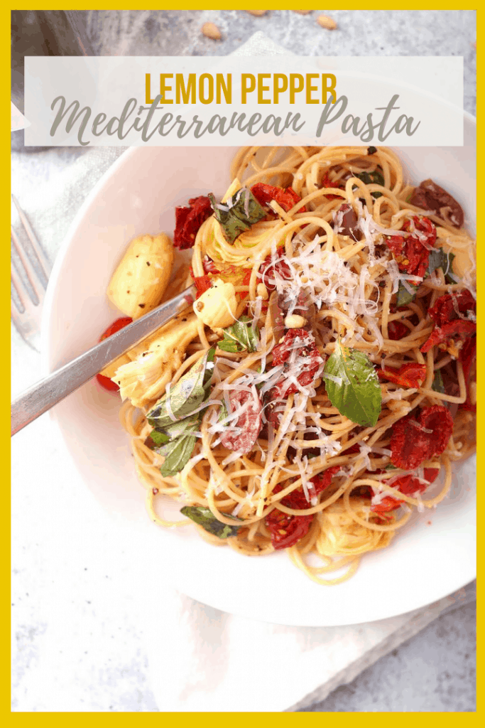 Vegan Mediterranean Pasta! It's a light and refreshing pasta dish made with angel hair pasta, tomatoes, olives, and artichokes. It's all tossed with fresh lemon juice, olive oil, and vegan parmesan cheese for a simple vegan meal made in under 20 minutes!