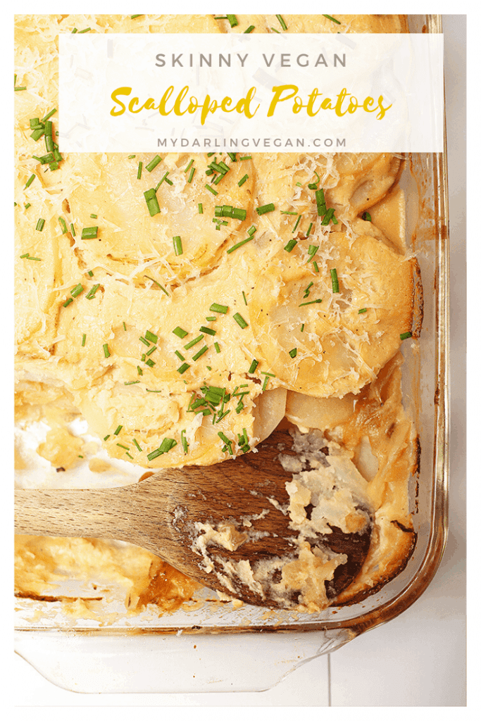 Vegan scalloped potatoes! It's a healthy spin on a classic family favorite. These skinny scalloped potatoes are made with layers of Russet potatoes and cheesy cauliflower sauce that's topped with vegan parmesan cheese and fresh chives. So good!