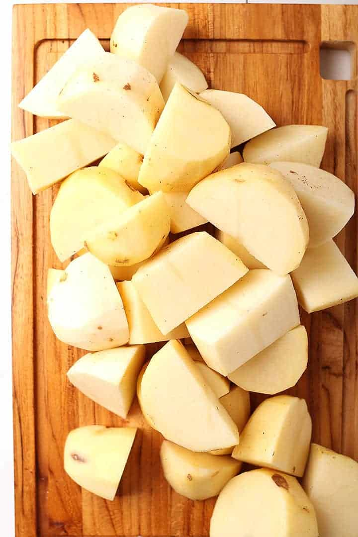Chopped russet potatoes on cutting board