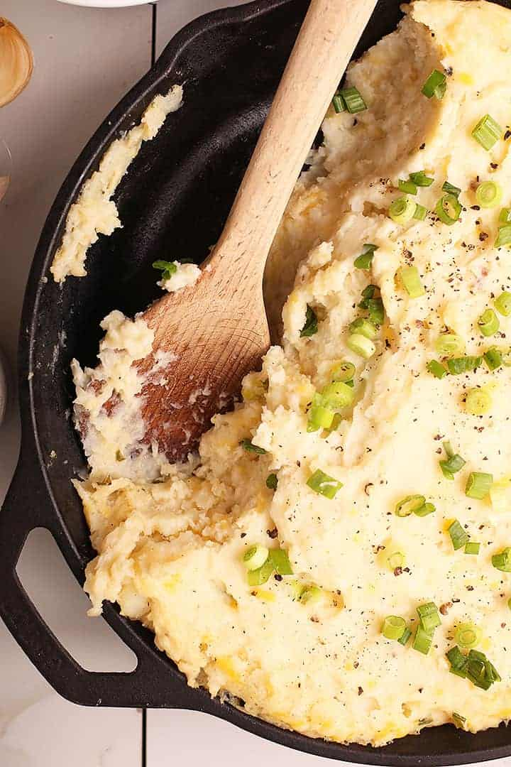 Cheesy mashed potatoes in cast-iron skillet