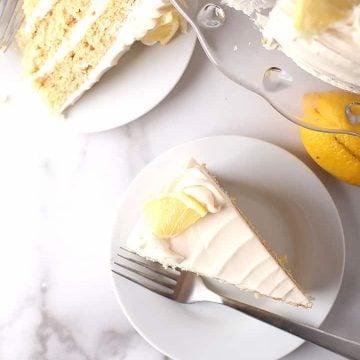 Two slices of lemon cake on white plates
