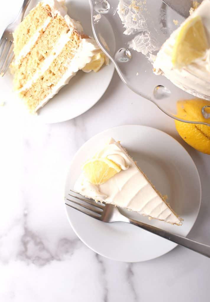 Two slices of vanilla cake on white plates