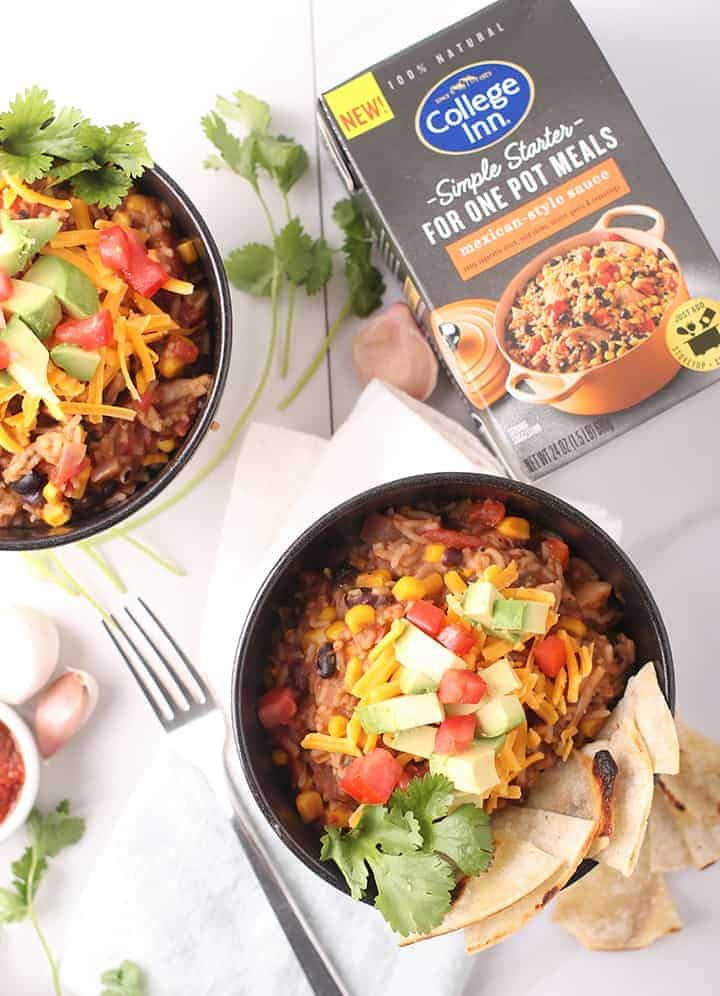 Two vegan burrito bowls with forks