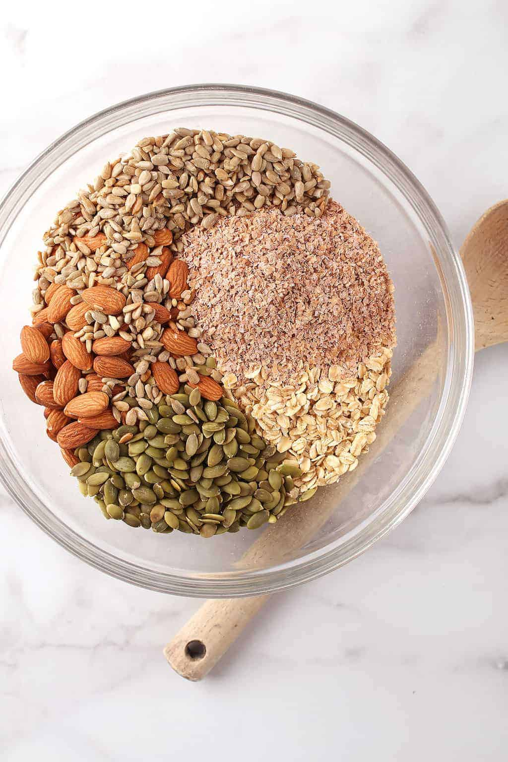 Oats, seeds, and nuts in a mixing bowl