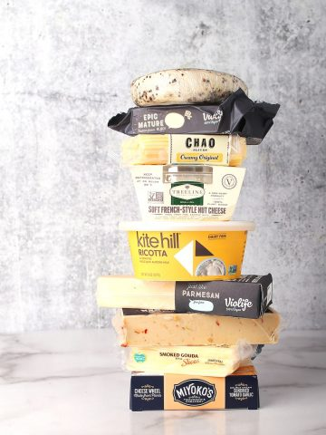 Stack of different store bought vegan cheeses