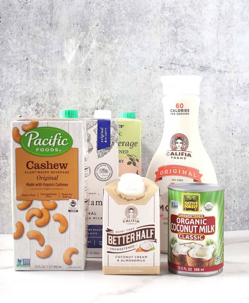 A variety of plant-based milks and creamers
